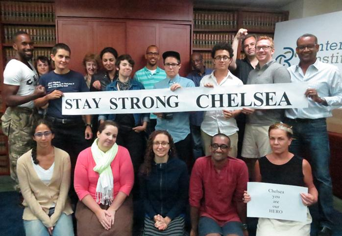 """CCR staff holding a sign that reads """"Stay Strong Chelsea"""""""