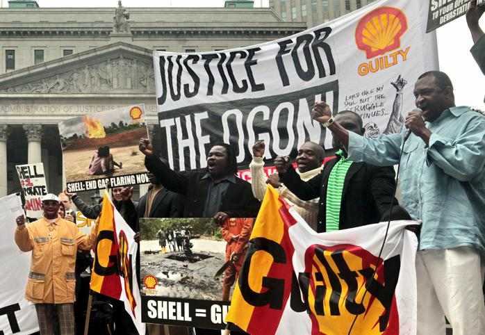 """A protest in front of the U.S. Supreme Court, signs read """"Justice for the Ogoni"""""""